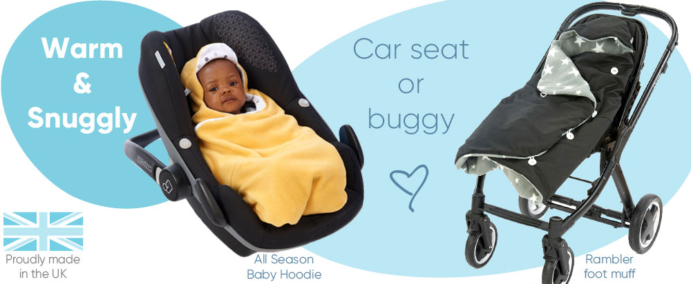 warm and snuggly baby in morrck baby car seat wrap