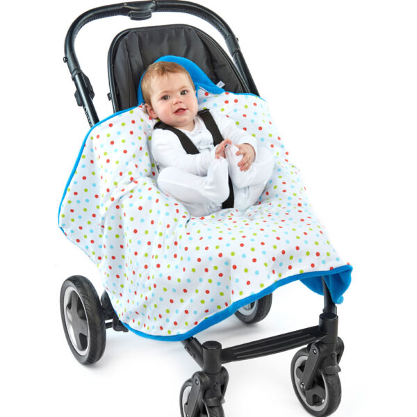a baby in a morrck mediterranean blue and spot car seat blanket unwrapped in a buggy