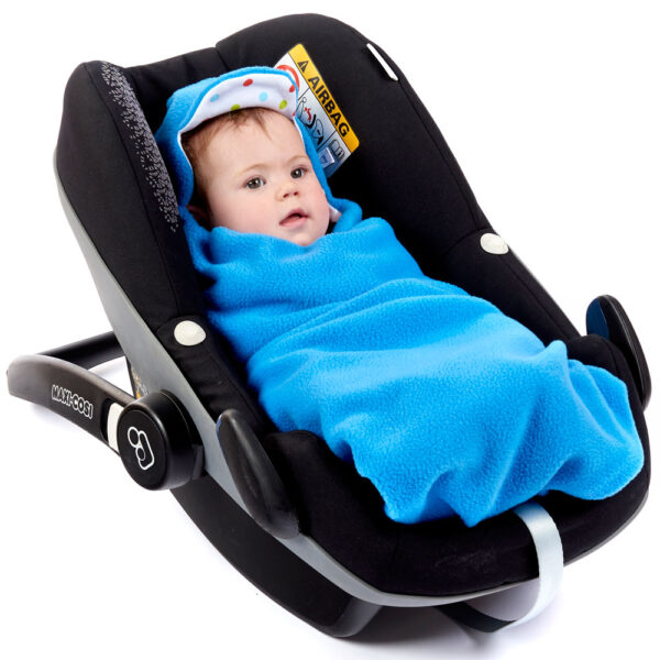 a baby wrapped in a morrck mediterranean blue and spot car seat blanket in a car seat