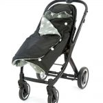 a morrck black and grey rambler footmuff wrapped in a buggy