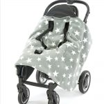 a morrck black and grey rambler footmuff unwrapped in a buggy