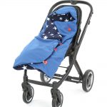 a morrck blue and navy rambler footmuff wrapped in a buggy