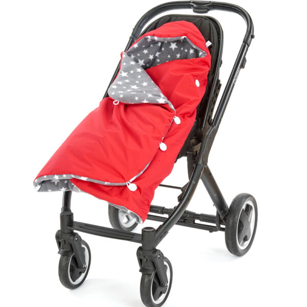 a morrck red and grey rambler footmuff wrapped in a buggy