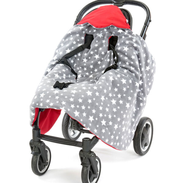 a morrck red and grey rambler footmuff unwrapped in a buggy