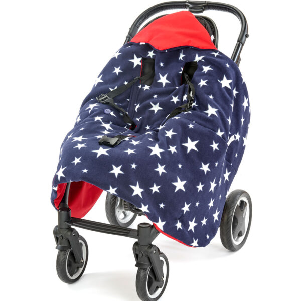 a morrck red and navy rambler footmuff unwrapped in a buggy