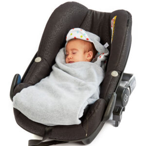 Sleeping baby wrapped up in a Morrck Baby Hoodie car seat blanket