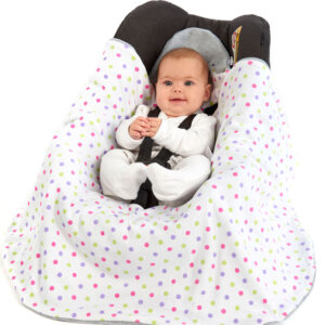 Happy baby in a Morrck Baby Hoodie car seat blanket