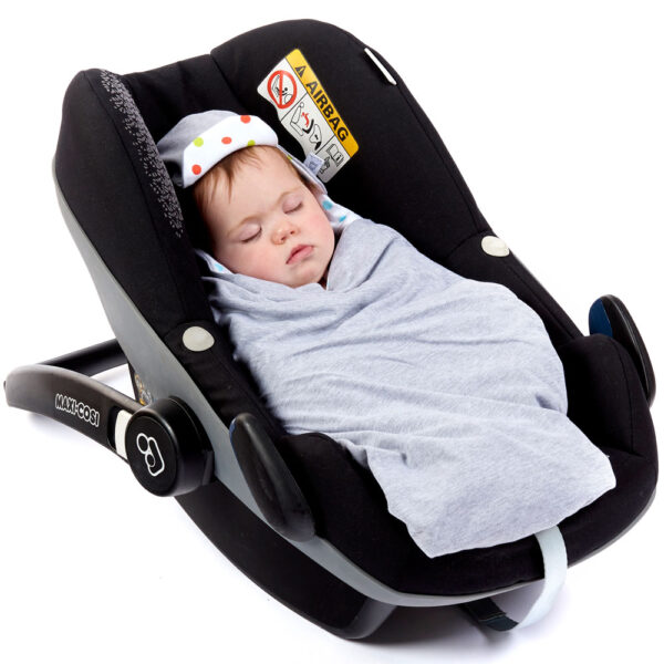 a baby wrapped in a morrck grey marl and spot lightweight car seat blanket in a car seat